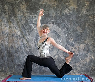 Woman doing Yoga posture King Arthurs pose