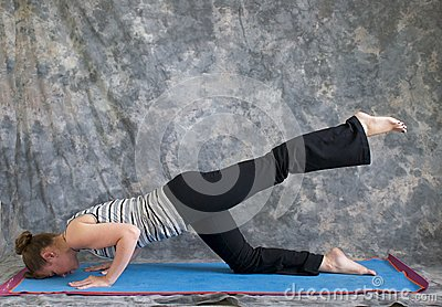 Woman doing Yoga posture sunbird pose left