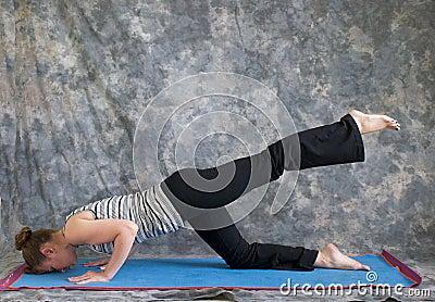 Woman doing Yoga posture sunbird pose left