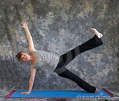Woman doing Yoga posture Vasisthasana
