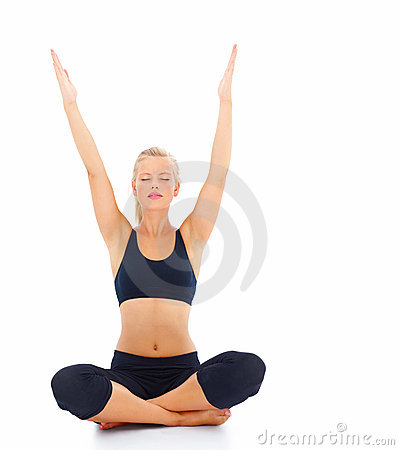 Woman doing yoga with raised hands isolated
