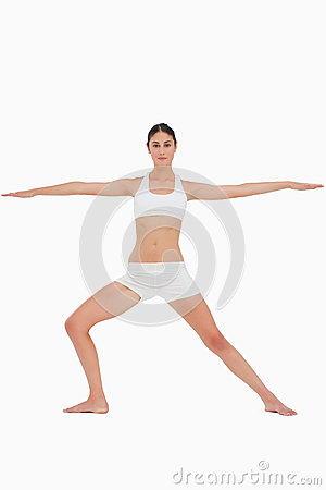 Woman doing the yoga warrior pose
