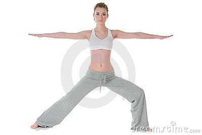 Woman doing yoga, warrior/Virabhadrasana II pose