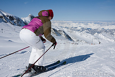 Woman downhill ski in apls