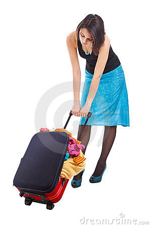 Woman dragging suitcase