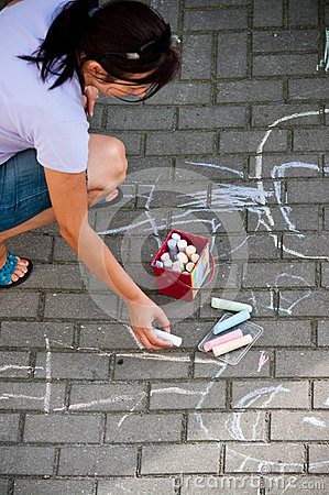 Woman drawing with chalks