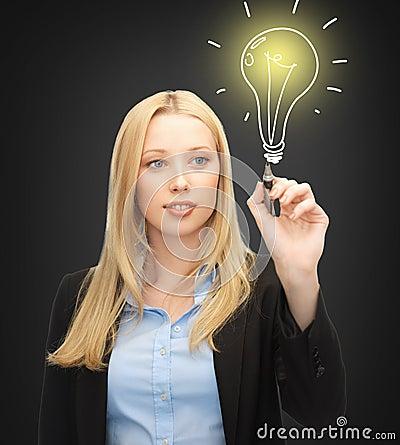 Woman drawing light bulb