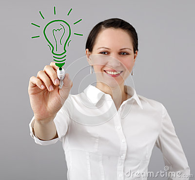 Woman drawing a light bulb