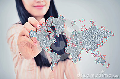 Woman drawing the world map