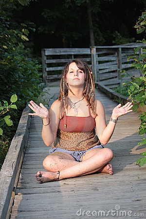 Woman with Dread Locks Meditating