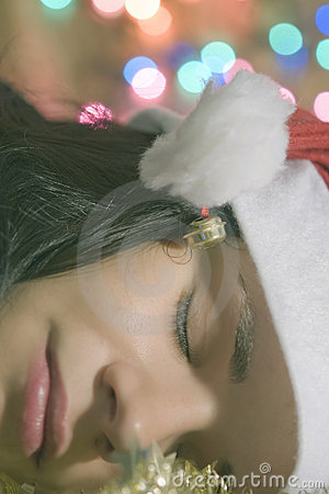 Woman dreaming Christmas dreams