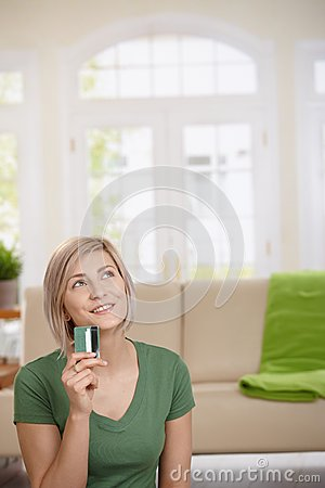 Woman dreaming with credit card in hand