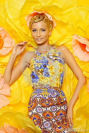 Woman in dress among big yellow flowers
