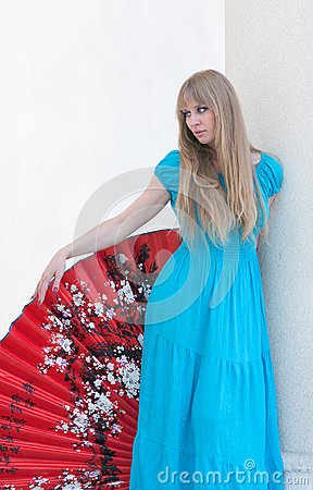The woman in a dress and a fan
