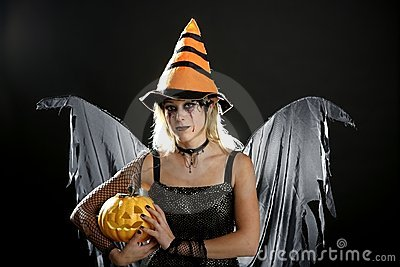 Woman dress for halloween and pumpkin
