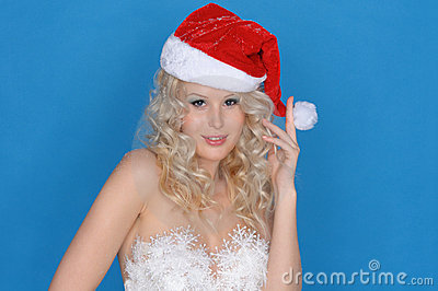 Woman in dress of snowflakes and Christmas hat