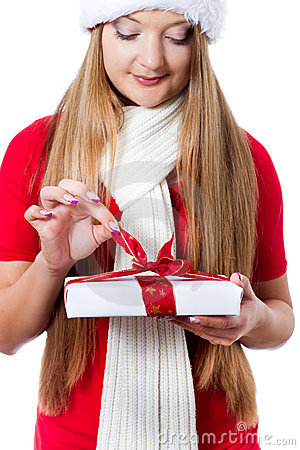 Woman dressed as Santa and opening xmas gift