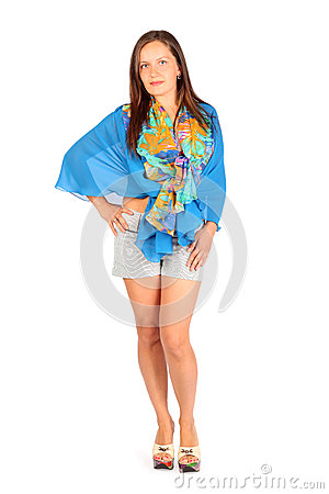 Woman dressed in shorts and pareo poses