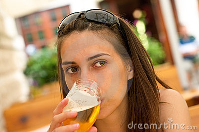 Woman drink a beer