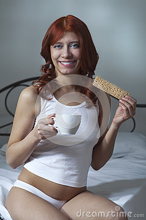 Free Woman Drink Coffee And Eat Toast In Bed Royalty Free Stock Photography - 29322037
