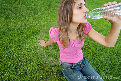 Woman drink water grass