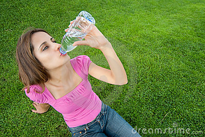 Woman drink water grass