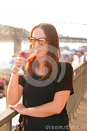 Free Woman Drinking A Wine In The City During A Sunset. Glass Of Red Wine. Concept Of Free Time In The City And Drinking Alcohol. Stock Photo - 117163810