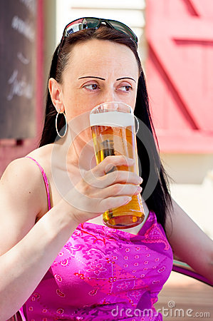 Woman drinking in a beer garden portrait