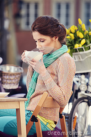 Free Woman Drinking Coffee In A Cafe On The Streets Royalty Free Stock Photography - 39364607