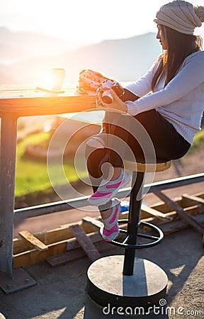 Free Woman Drinking Coffee In Sun Sitting Outdoor In Sunshine Light Enjoying Her Morning Coffee Stock Photography - 87450652