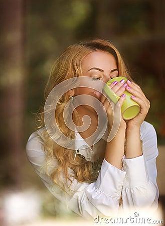 Free Woman Drinking Coffee Indoors, Enjoying The Aroma Of Beverage Royalty Free Stock Image - 49455566