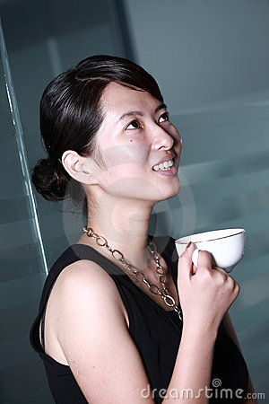 woman drinking coffee at office