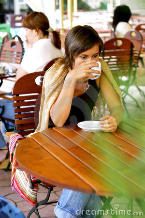 Woman drinking at a coffee shop
