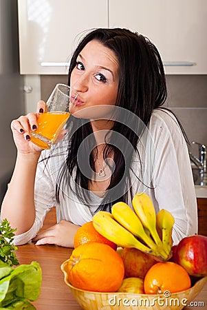 Free Woman Drinking Fresh Orange Juice Royalty Free Stock Photo - 18454905