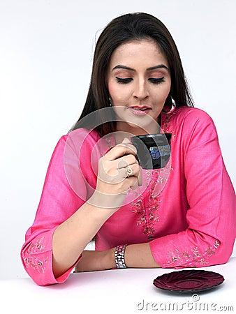 Woman drinking her tea