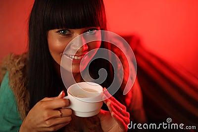 Woman drinking herb tea