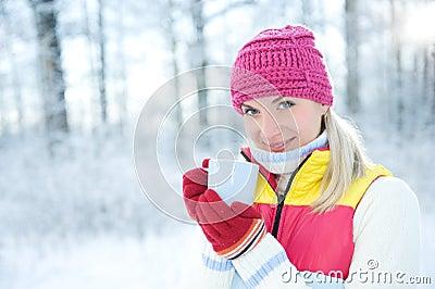 Woman drinking hot tea outdoors