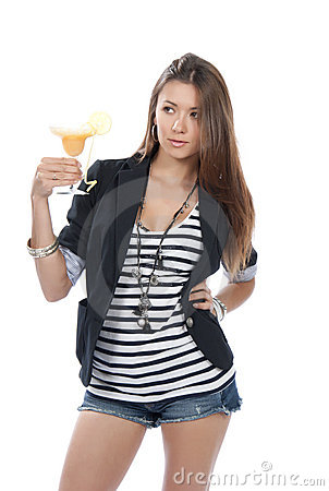 Woman drinking margarita cocktail