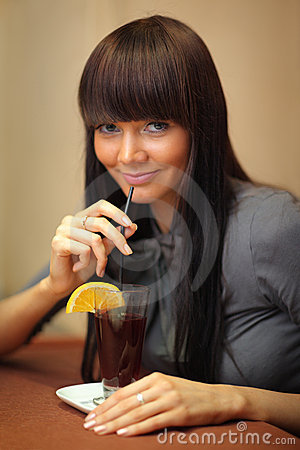 Woman drinking mulled wine.
