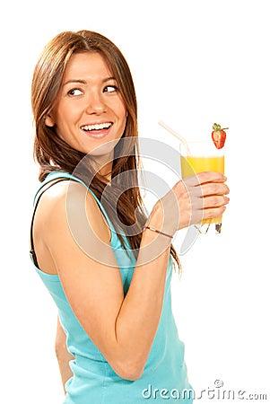 Woman drinking orange juice cocktail