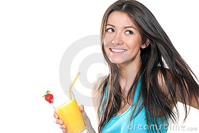 Woman drinking orange juice cocktail