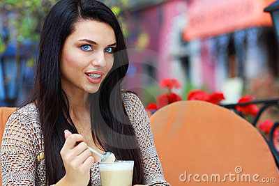 Woman drinking tea in a cafe outdoors
