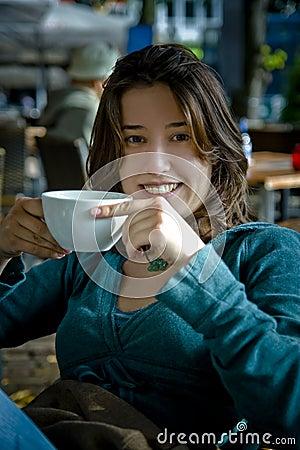 Woman drinking tea / coffee