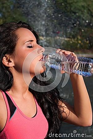 Woman Drinking Water Outside