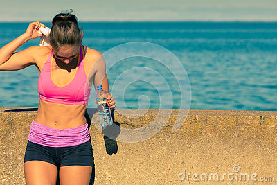 Woman drinking water after sport gym outdoor Stock Photo