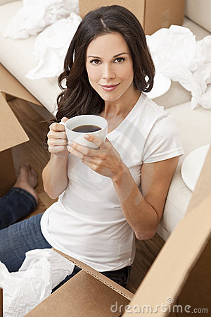 Woman Drinks Coffee Unpacking Boxes Moving House