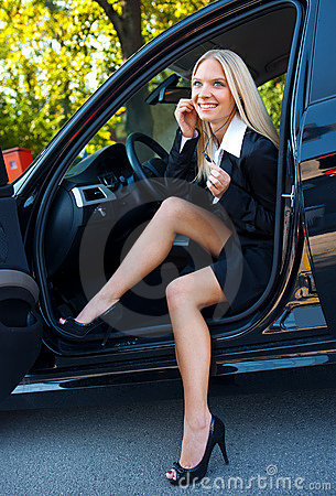 Woman driver with phone headset