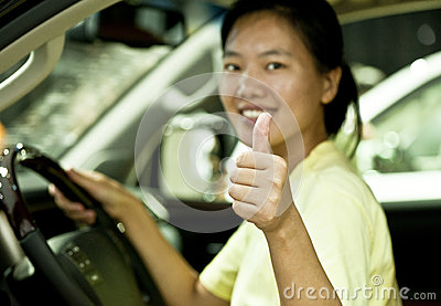 woman driver thumb up