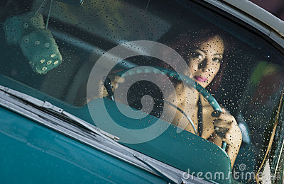 Woman driving classic car