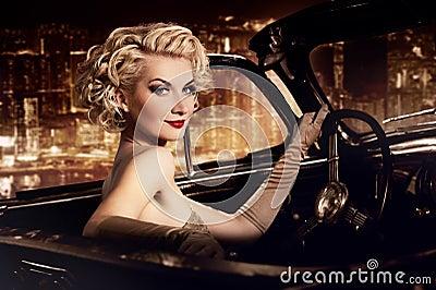 Woman driving retro convertible
